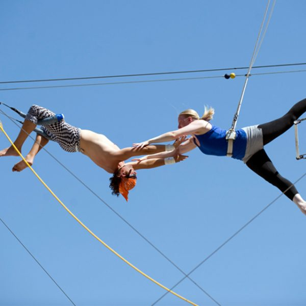 Two trapeze artists exercising