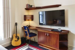 Desk with a chair, television and cupboard