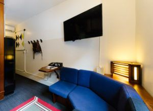 Sofa and television inside a quad room at Freehand Hotel Chicago