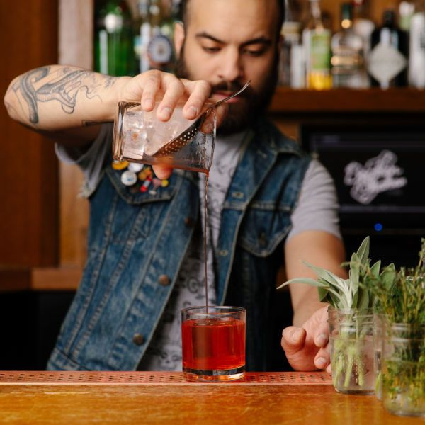 Barman making cocktails