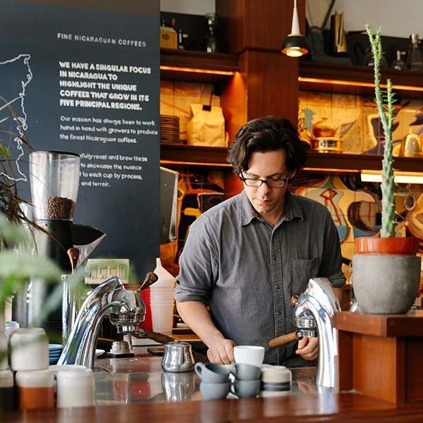 Barista preparing coffee at Café Integral