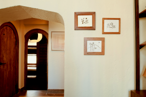 Penthouse hallway with frames on the wall