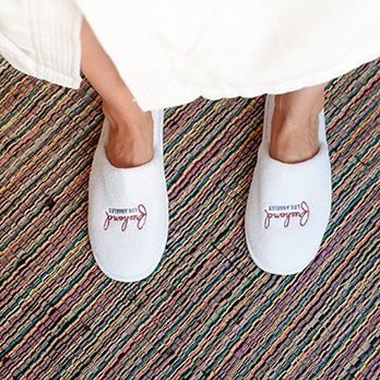 Slippers with the Freehand Hotel Los Angeles logo
