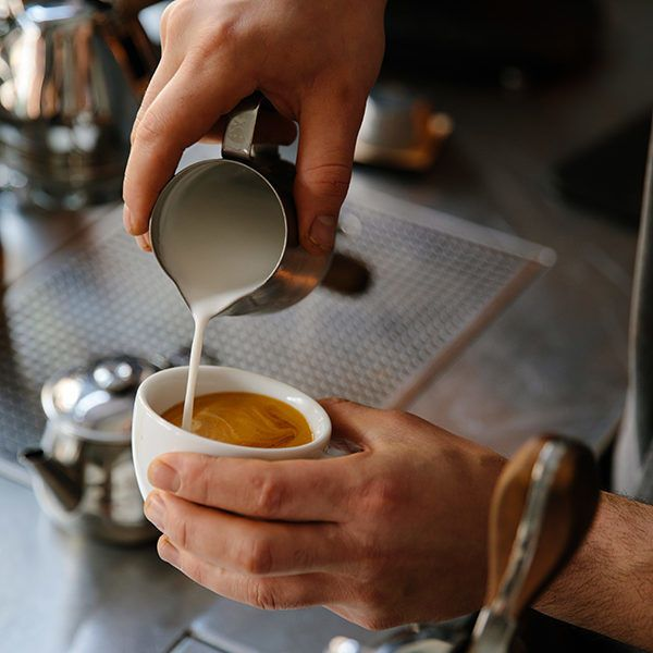 Hands pouring a cup of coffee