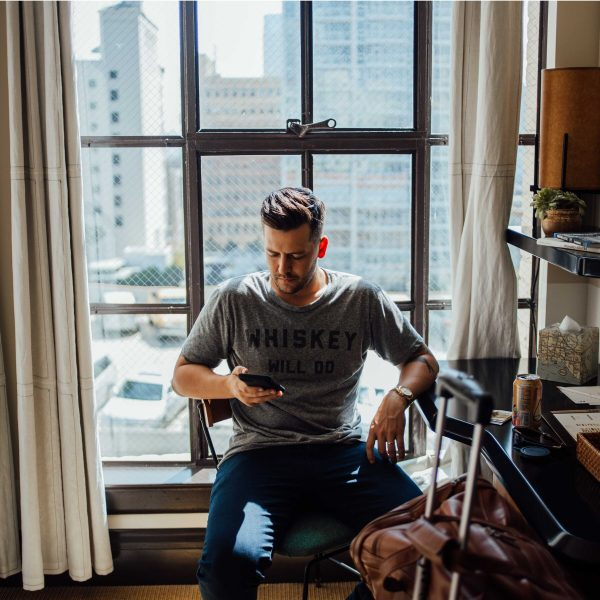 Men near a window in a Freehand Hotel