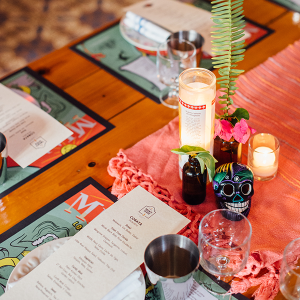 Table set with glasses, dishes, candles and menus