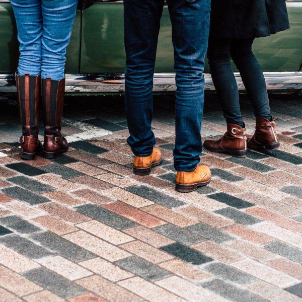 Three people's legs