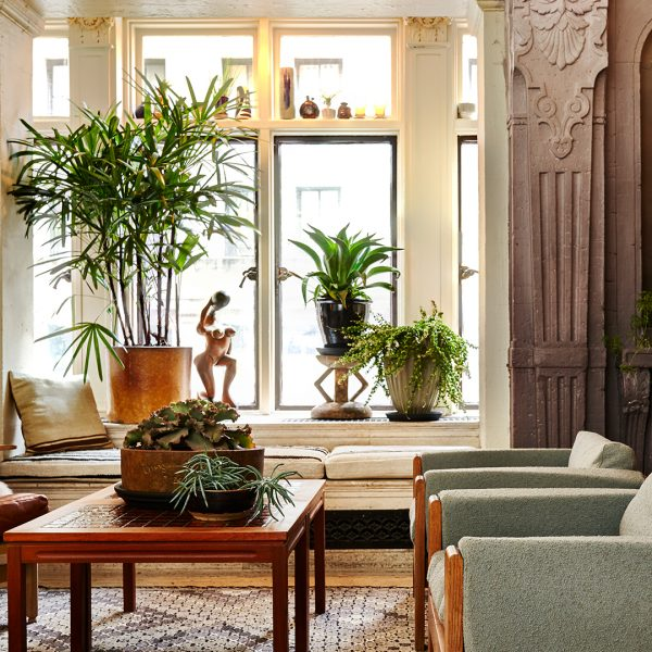 Fancy sitting room with armchairs and coffee table at Freehand Hotel New York