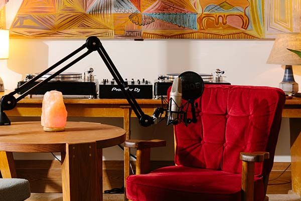 Podcast studio at Freehand Hotel New York with a red armchair and a microphone