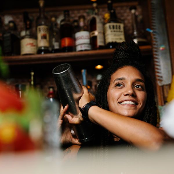 Barwoman making cocktails