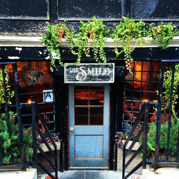 Partners Matt Kliegman and Carlos Quirarte opened The Smile in March 2009. The cozy, subterranean café on picturesque Bond Street in Downtown Manhattan is located in a landmark 1830s Federal-style townhouse