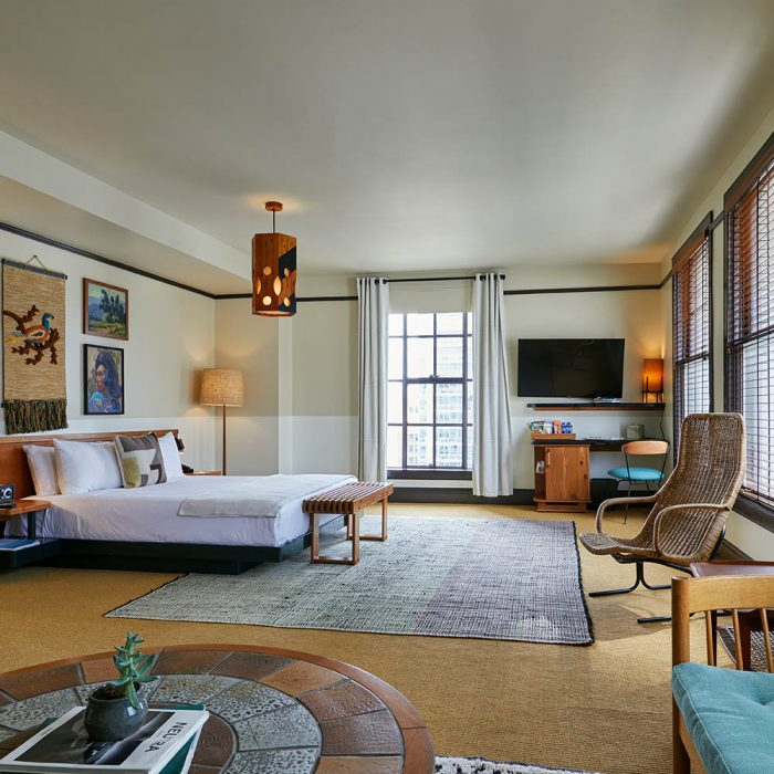 hotel suite with bed, sits and windows